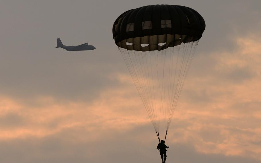 Paratroopers assigned to Special Operations Command Africa conduct static-line airborne operations from a U.S. Air Force C-130 Hercules over the Hopfenohe Drop Zone at Grafenwoehr Training Area, Germany, Sept. 25, 2013.