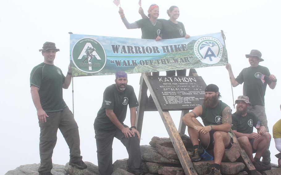 Warrior Hike celebration on the summit of Mount Katahdin in Baxter State Park, Maine, marks the northern terminus of the Appalachian Trail.  From left: director Sean Gobin, who joined the hikers at the summit; Kevin Reed, Sharon Smith, Stephanie Cutts, Tom Gathman, Steve Clendenning and Rob Carmel. Smith, Cutts, Gathman and Carmel completed the entire 2,185-mile hike.