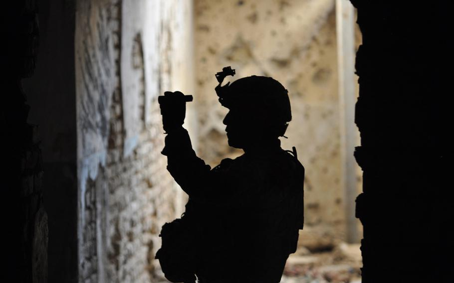 Staff Sgt. Clarence C. Elicio, squad leader for Company A, 1st Battalion, 294th Infantry Regiment, Guam Army National Guard, inspects a tunnel at Qala-I-Jangi, Balkh province, northern Afghanistan.