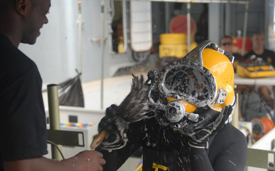 A diver with the 7th Engineer Dive Detachment, 130th Engineer Brigade, soaps up on his diver equipment to make sure there are no leaks before diving into the ocean on Oct. 1, 2013, during Deep Blue, an annual exercise designed to reinforce safety and tactical proficiency during dive operations at Joint Base Pearl Harbor-Hickam.