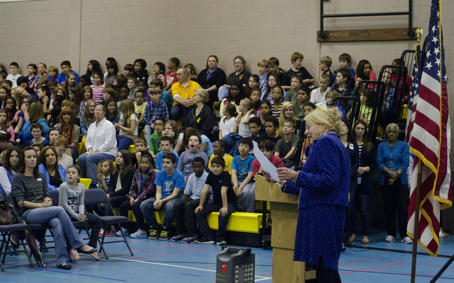 """Mary Zimmerman-Bayer, principal, leads an assembly at Lakenheath Middle School on RAF Feltwell, England, celebrating the school being named a National Blue Ribbon School for 2013 by the U.S. Department of Education, Friday, Oct. 4, 2013. The annual award is given to schools where """"students perform at very high levels or where students are making significant gains in academic achievement,"""" according the award program's website. The school will receive a plaque and flag in November."""