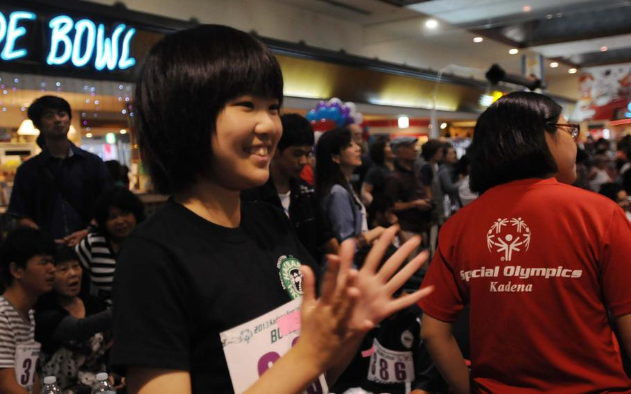 Athletes and family members cheer each other on at the 14th-annual Kadena Special Olympics bowling event in Chatan, Okinawa.