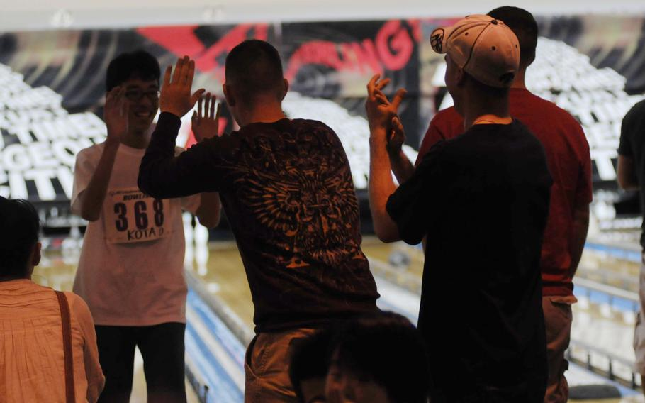 Volunteers at the 14th-annual Kadena Special Olympics bowling event in Chatan, Okinawa, are mostly servicemembers and their families.