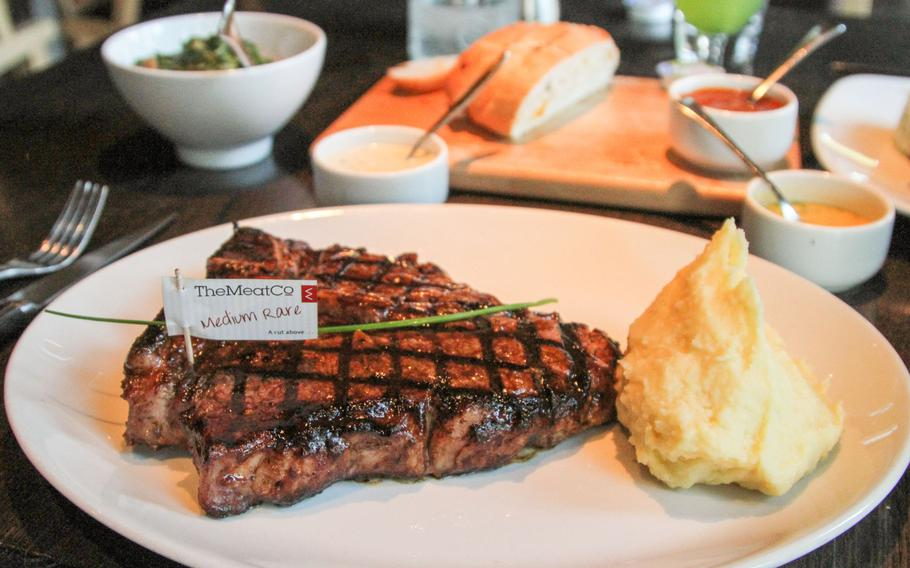 At The Meat Co restaurant in Bahrain, steaks come with a basic side dish -- mashed potatoes or vegetables. Choose from a variety of sauces, such as creamy garlic and peri peri, pictured in the background. Every meal comes with complimentary bread.