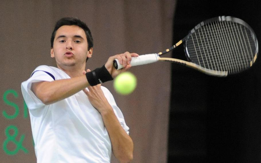 Two-time defending champ Ajdin Tahirovic of Patch returns a serve from Lakenheath's Peter Kovats in a semifinal at the 2012 DODDS-Europe tennis championships. Tahirovic is not competing in DODDS-Europe tennis this season.