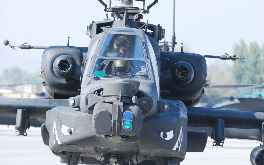 An AH-64 Apache helicopter from 1st Attack/Reconnaissance Battalion, 10th Combat Aviation Brigade, taxis down the flight line after a security and reconnaisance mission, Oct. 11, 2013, at Forward Operating Base Fenty, Afghanistan.