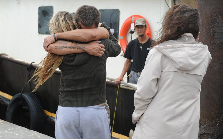 Brooke Peaver embraces her boyfriend Theran Thomas, a deckhand aboard the 88-foot shrimp boat Sea King, which began taking on water and was in danger of sinking off Ponte Vedra, Fla., on Oct. 15, 2013. A Coast Guard boatcrew from Station Mayport in Atlantic Beach, Fla., responded to the crew's call for help, assisted with dewatering the Sea King, and escorted the vessel to Safe Harbor Marina in Atlantic Beach.