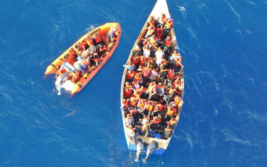 The crew of the Coast Guard Cutter Venturous repatriated 86 Haitian migrants to Cap Haitien, Haiti on Oct. 16, 2013, following an at-sea interdiction approximately 4 nautical miles off Desecheo Island, Puerto Rico.