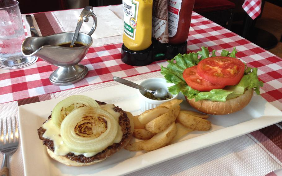 Nick's restaurant has been outside the air base in Saitama, Japan, since 1960. The Johnson Cheeseburger, named after the American air base, costs about $11 in 2013.
