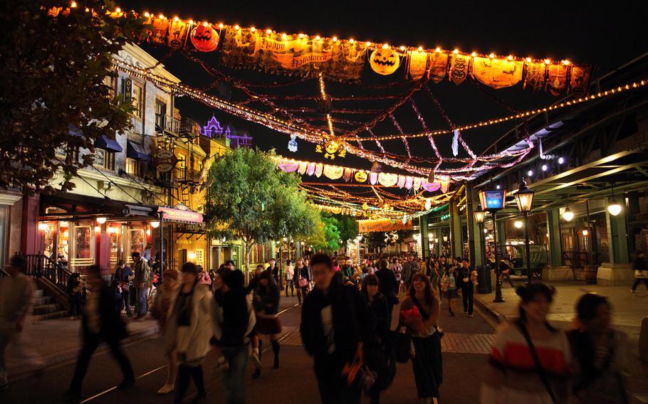 Park patrons walk under the elaborate Halloween decorations at Disney Sea in Tokyo.