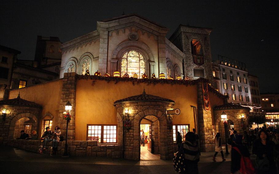 Carved jack-o'-lanterns decorate buildings and light fixtures all over Disney Sea in Tokyo.
