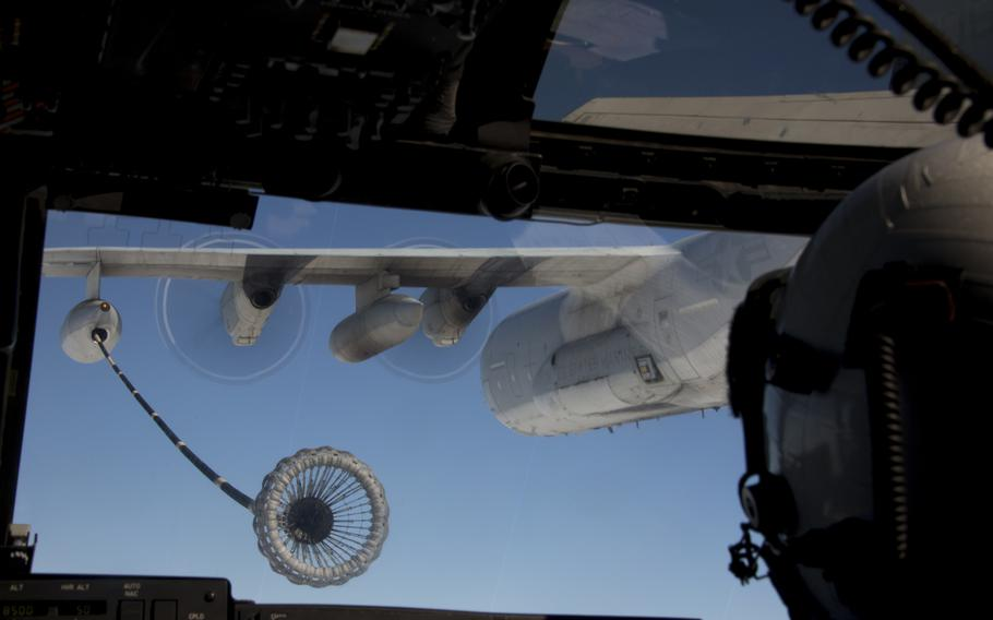 A pilot with Marine Medium Tiltrotor Squadron 161 aims to connect to a KC-130J Super Hercules to receive fuel in flight aboard Marine Corps Air Station Miramar, Calif., on Oct. 24, 2013.