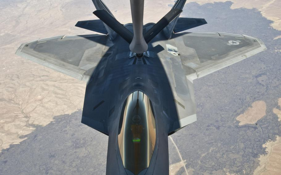 An F-22 Raptor assigned to the 49th Fighter Wing at Holloman Air Force Base, N.M., receives fuel from a KC-135 Stratotanker from McConnell Air Force Base, Kan., on Oct. 23, 2013.