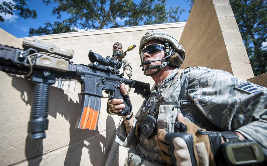 Staff Sgt. Pablo Cancel keeps a lookout at the military operations in urban terrain, or MOUT, village during Exercise Global Eagle on Oct. 17, 2013, at Moody Air Force Base, Ga.