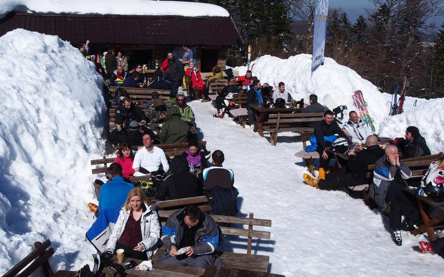 Skiers and snowboarders relax and enjoy some refreshment and some sun at Bjelasnica ski resort near Sarajevo, Bosnia-Herzegovina.