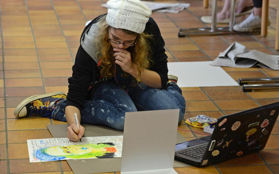 In the mixed media workshop at Creative Connections Alexa Gunn of Hohenfels works on a self-portrait. More than 160 students from DODDS-Europe high schools participated in this year's event that features 11 workshops in the visual and performing arts.