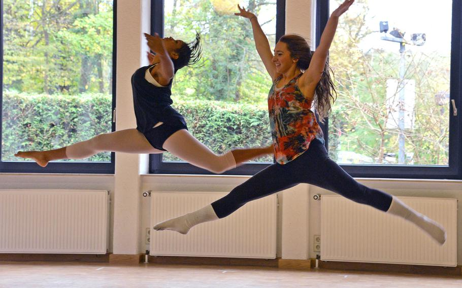 Rota's Sofia Ortiz, right, and Ashley Calabro of Naples leap through the air during a  dance rehearsal at Creative Connections. More than 160 students from DODDS-Europe high schools participated in this year's week long event that features 11 workshops in the visual and performing arts.