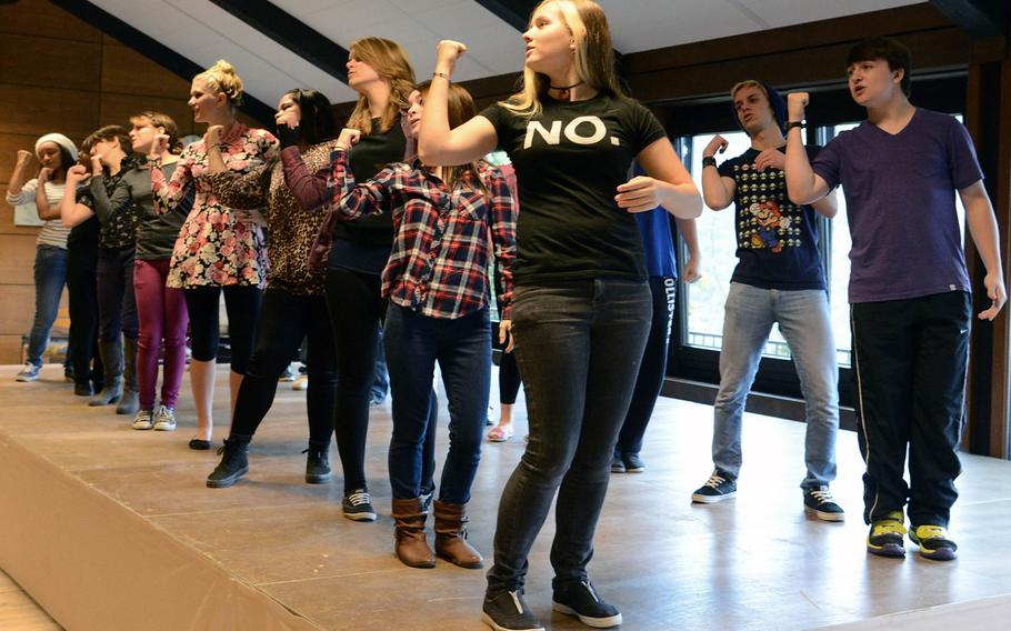 The show choir at this year's Creative Connections rehearse a Browdway tune during a morning session at the week long program. More than 160 students from DODDS-Europe high schools participated in this year's event that features 11 workshops in the visual and performing arts.
