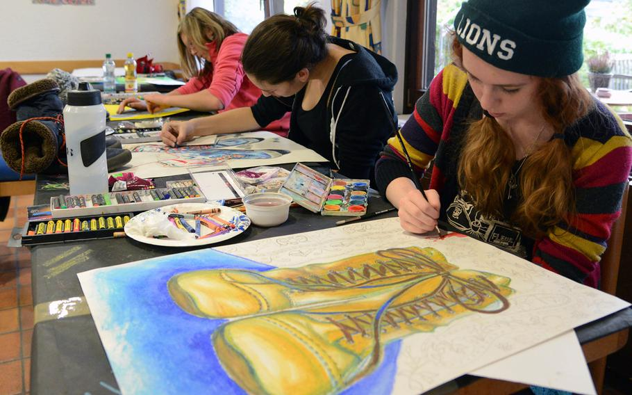 AFNORTH's Hailey Jenkins, Cassidy Harless and Eliska Volencove, from right, work on their art in the oil pastels workshop at Creative Connections. More than 160 students from DODDS-Europe high schools participated in this year's event that features 11 workshops in the visual and performing arts.