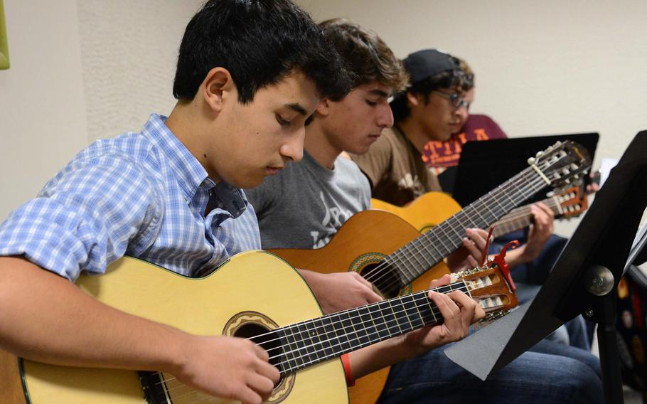 Participants in the guitar workshop practice a song during a session at this year's Creative Connections. More than 160 students from DODDS-Europe high schools participated in this year's event that features 11 workshops in the visual and performing arts.