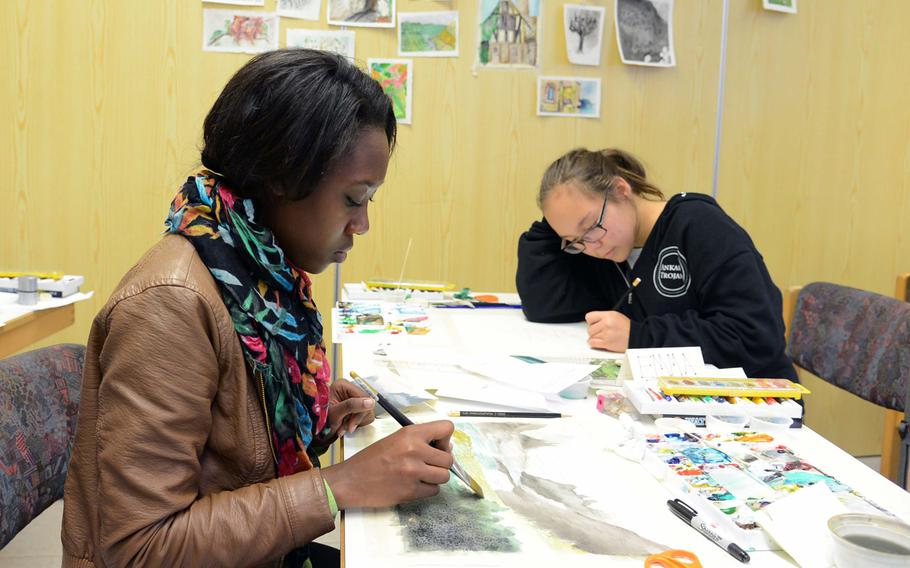 In the watercolor workshop at this year's Creative Connections, Ashley Herndon of Hohenfels, left, and Emma Rook of Ankara work on their pieces. More than 160 students from DODDS-Europe high schools participated in this year's event that features 11 workshops in the visual and performing arts.