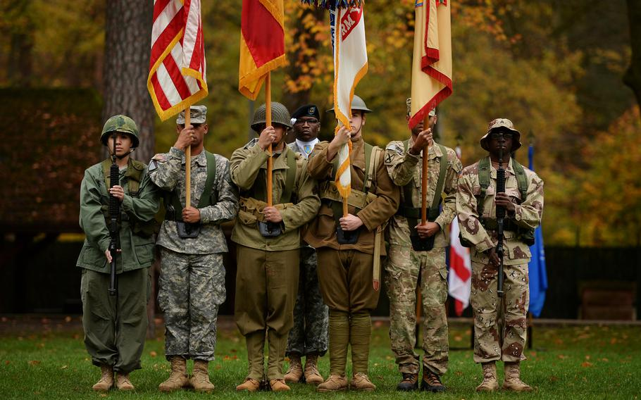 The 21st Theater Sustainment Command color guard wears period uniforms as they perform for a Veterans Day Observance at Panzer Kaserne, Germany,  Thursday, Nov. 7, 2013.