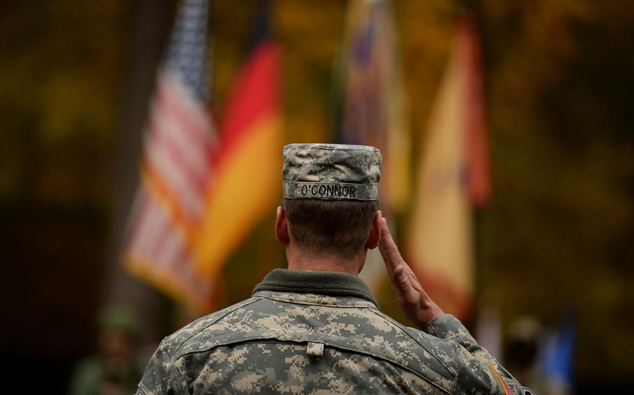 Maj. Gen. John R. O'Connor, commander of the 21st Theater Sustainment Command, salutes the colors Thursday during his unit's Veterans Day observance at Panzer Kaserne, Germany, Thursday, Nov. 7, 2013.