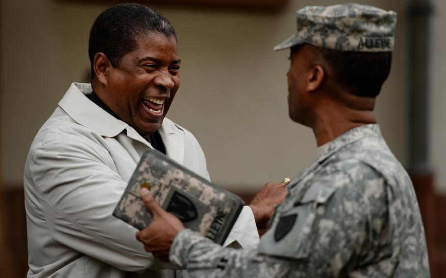 Retired Command Sgt. Maj. Arthur F. Peete, left, shakes hands with Maj. Eric Alleyne at the end of the 21st Theater Sustainment Command Veterans Day observance at Panzer Kaserne, Germany, Thursday, Nov. 7, 2013. Peete was special guest at the observance.