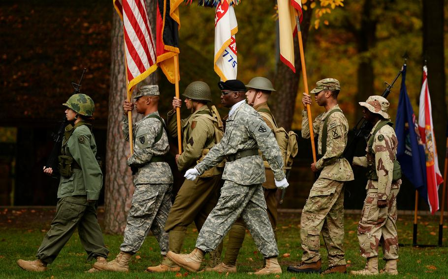 The 21st Theater Sustainment Command color guard marches off the Panzer Kaserne parade field for a Veterans Day Observance in Kaiserslautern, Germany, Thursday, Nov. 7, 2013.