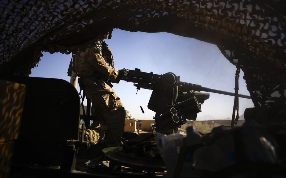 Sgt. Alex Hatfield with 3rd Squadron, 2nd Cavalry Regiment test fires a mounted 50-caliber machine gun from a Stryker before leaving Forward Operating Base Pasab to conduct a partnered patrol with Afghan police in the local area north of the FOB in the Zhari southern Afghanistan's Kandahar province on Oct. 21, 2013.
