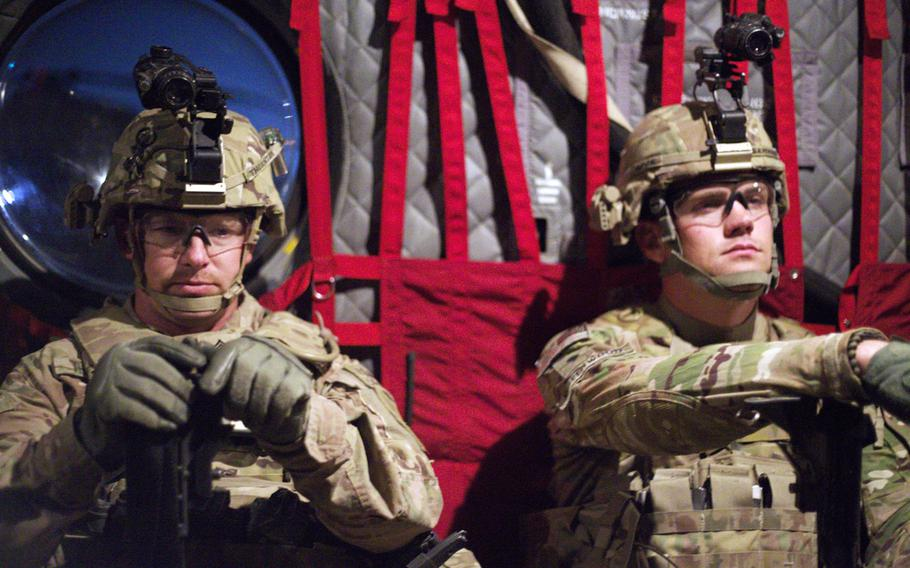 Staff Sgt. Donald Thornton, mortars section leader, and Spc. Aaron Greenwood, a mortarmen, wait for the CH-47 Chinook to depart for their exercise from Camp Marmal, Afghanistan, on Nov. 9, 2013.
