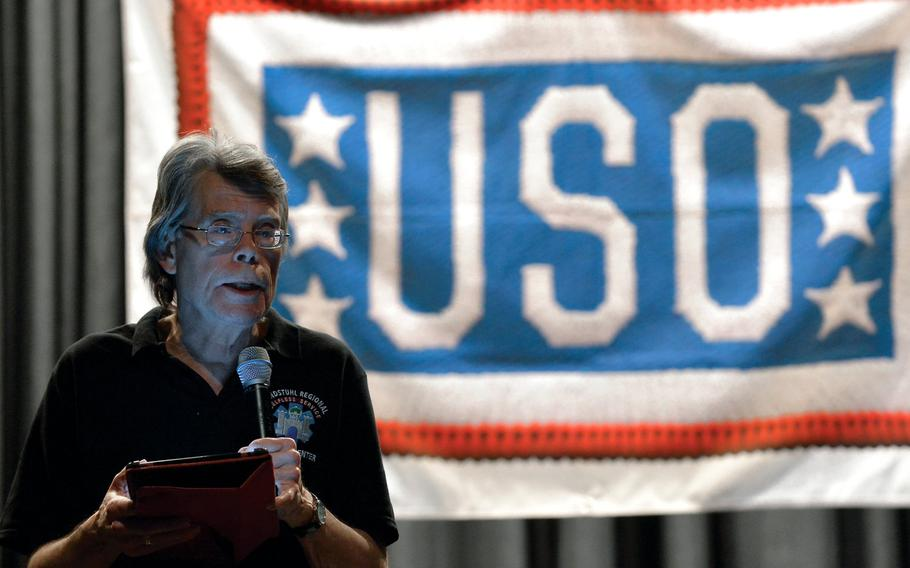 """Author Stephen King reads from his recently released book """"Doctor Sleep,"""" a sequel to his 1977 horror novel """"The Shining,"""" Monday, Nov. 18, 2013, at Ramstein Air Base, Germany."""