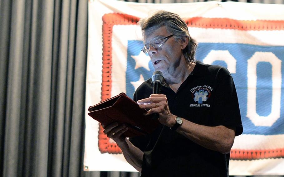 """Stephen King, American author of contemporary horror, suspense, science fiction and fantasy, reads from his new book,"""" Doctor Sleep,"""" during a USO event Monday, Nov. 18, 2013, at Ramstein Air Base, Germany."""