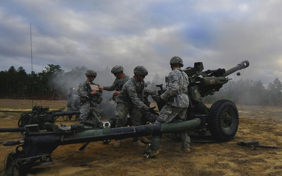 Paratroopers from  the 319th Airborne Field Artillery Regiment, 2nd Brigade Combat Team, 82nd Airborne Division, fire newly fielded M119A3 howitzers on Nov. 22, 2013, at Fort Bragg, N.C.