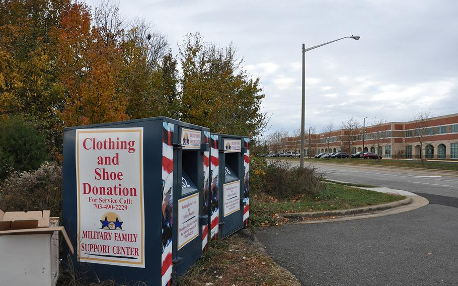 A clothing donation bin sits by the roadside near an office park in Woodbridge, Va. Officials from the Military Family Support Center say they have no affiliation with the collection efforts, even though their name and logo is on the bins.