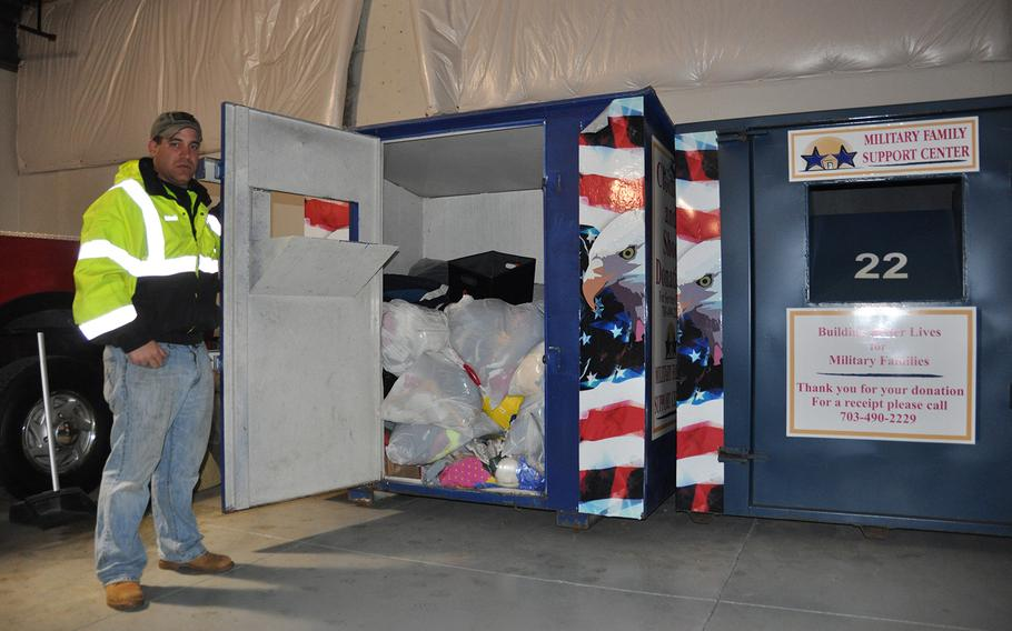 Adam Leitao, veteran of Iraq and Afghanistan who runs Adam's Towing in Leesburg, Va., shows off the contents of one of the misleading Military Family Support Center bins that he has impounded in recent months. The military charity does not collect items in the bins and receives no compensation for the use of their name.