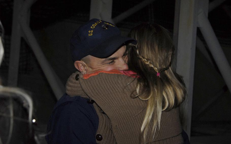 Petty Officer 1st Class John Savastano, assigned to Coast Guard Cutter Waesche, hugs his daughter at Coast Guard Island in Alameda, Calif., Friday, November 29, 2013. The Waesche's crew returned from a 109-day deployment in Gulf of Alaska, Bering Sea and Arctic Ocean.