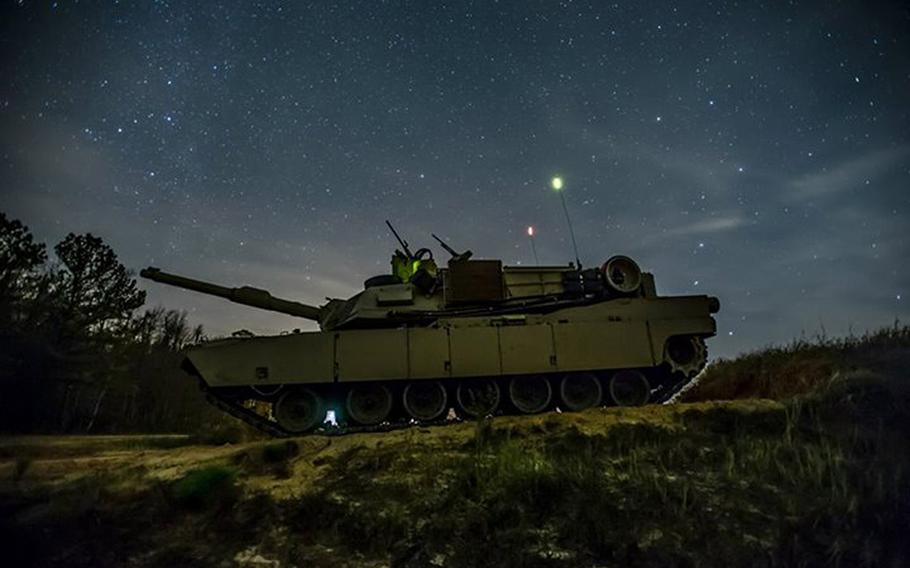 """An M1A2SEP Abrams tank from Company D, 1st Battalion, 64th Armor Regiment """"Desert Rogues,"""" sits ready at Red Cloud Range, Dec. 6, 2013. The unit was conducting Gunnery Table V, the practice phase before the final qualification phase, Gunnery Table VI."""
