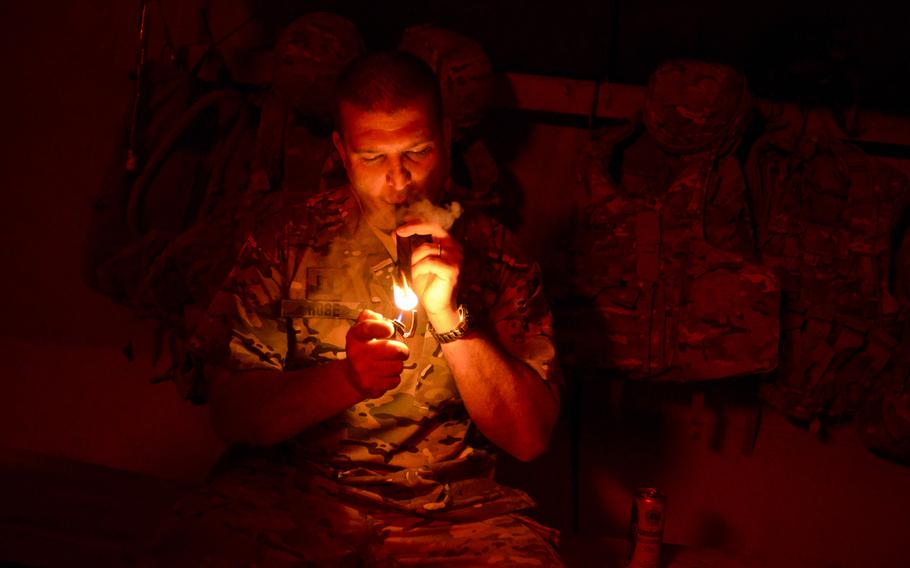 Capt. Patrick Rose, a physician assistant with the 2nd Cavalry Regiment, smokes a cigar at Forward Operating Base Zangabad in southern Afghanistan's Kandahar province, on Oct. 3, 2013. ''There's no better way to unwind after a bad, or a good, day,'' said Rose, founder of FOB Zangabad's unofficial cigar club.