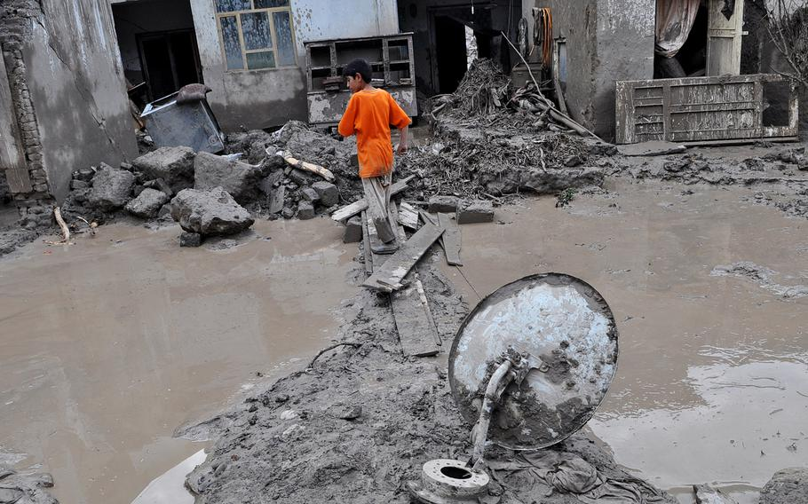 A satellite dish sits in the mud in the town of Surobi, Afghanistan, about 40 miles east of Kabul. On Aug. 3, 2013, Surobi was devastated by flash floods. Upward of 80 people were reportedly killed across two provinces.