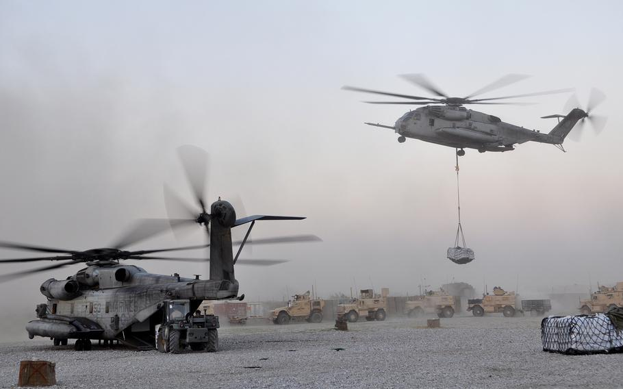 A UH-53 and UH-59 drop off supplies at Forward Operating Base Jackson in Sangin district, Afghanistan. Sangin has become a symbol for the insurgency, the Afghan government and the NATO coalition alike, and in recent weeks has become the focus of intense fighting.