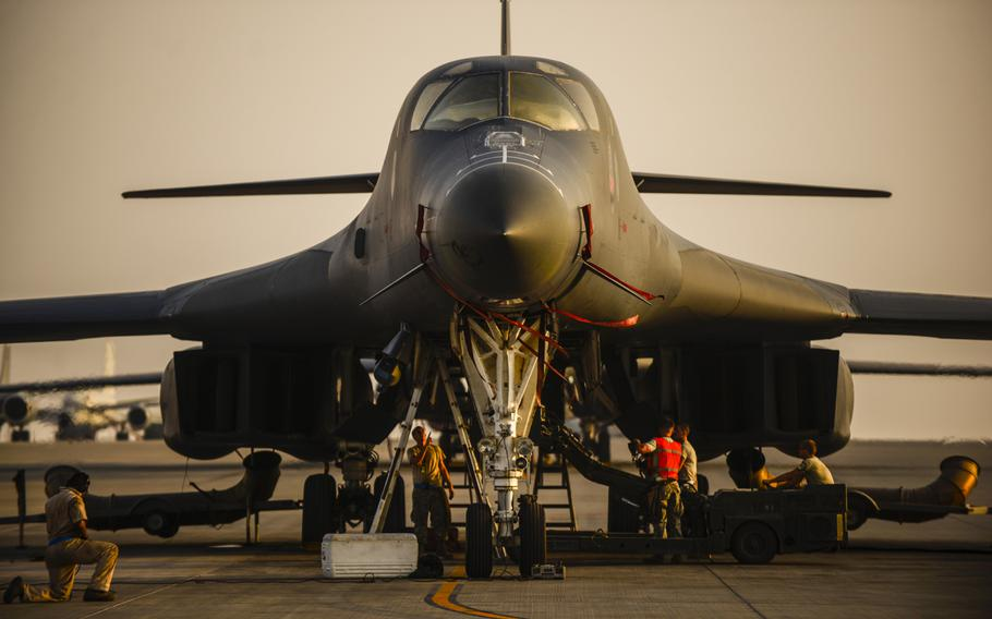 Servicemembers with the 9th Expeditionary Bomb Squadron load ordnance onto a B-1B Lancer at a location in Southwest Asia on Sept. 12, 2013.