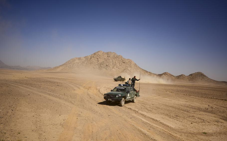 Afghan police ride in a Ford Ranger during a recent partnered patrol with 3rd Squadron, 2nd Cavalry Regiment based at Forward Operating Base Pasab in the desert of Kandahar province's Zhari district on Oct. 21, 2013.