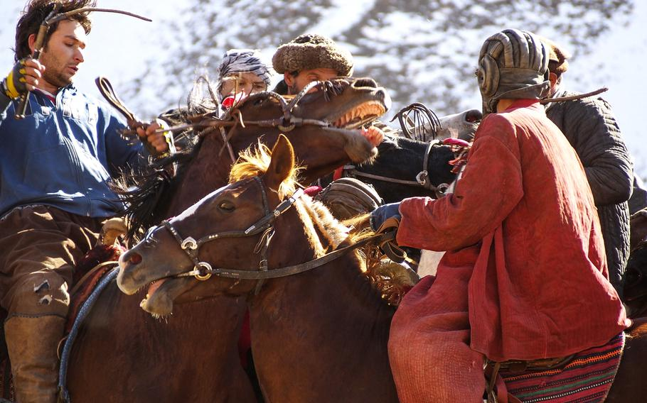 Riders clash during a January buzkashi match in Afghanistan's Panjshir Valley. The game is something of a national sport in the country, especially popular in the north.