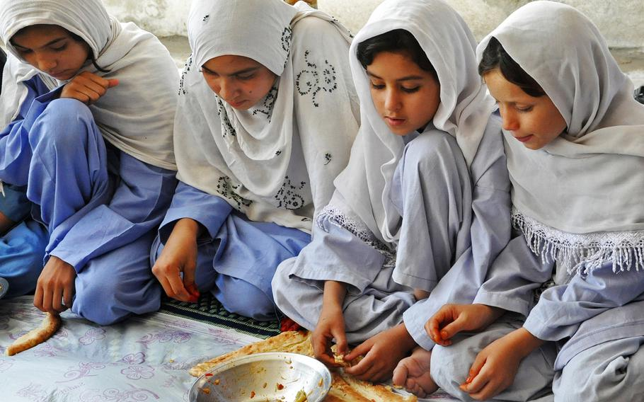 The two young Afghan girls on the right are addicted to opium. The girls and their mothers are all receiving treatment at the Welfare Association for the Development of Afghanistan drug rehabilitation center in Jalalabad, Afghanistan. The U.N. Office on Drugs and Crime estimated that in 2010, 40 percent of drug addicts in Afghanistan were women and children.