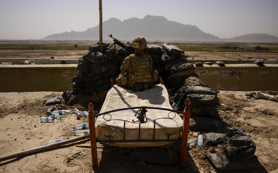 Spc. Derek Smith, a gunner with the 2nd Cavalry Regiment, pulls security from the roof of the Panjwai district headquarters in southern Afghanistan's Kandahar province on Oct. 5, 2013.