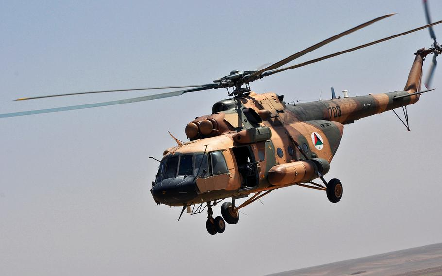 An Afghan air force Mi-17 helicopter flies over Helmand province during a mission to carry troops as well as wounded and dead soldiers in June 2013.