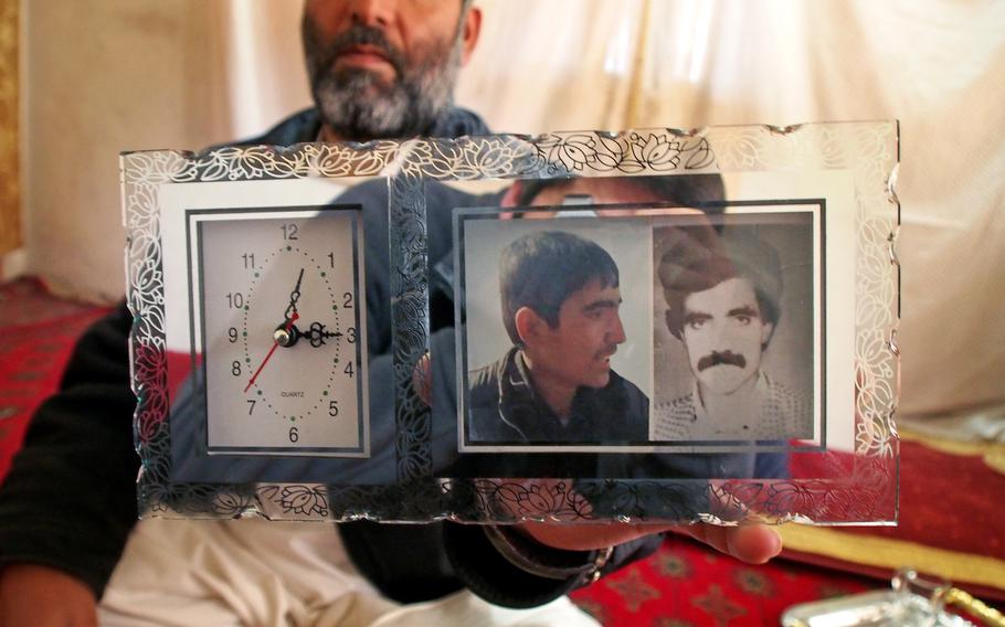 """Mohammad Yasin holds a photo of his nephew,  Ayoub Khan, who has been missing since August. After Khan disappeared, Yasin's family called in to the popular Afghan radio show """"In Search of our Missing Loved Ones"""" to ask for help in finding him."""