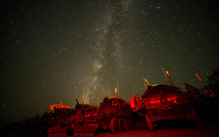 The dark skies above Forward Operating Base Zangabad in southern Afghanistan's Kandahar province provide one of the key elements needed to photograph the Milky Way. Strykers with the 2nd Cavalry Regiment are painted with red light to provide a foreground in this 15-second exposure.