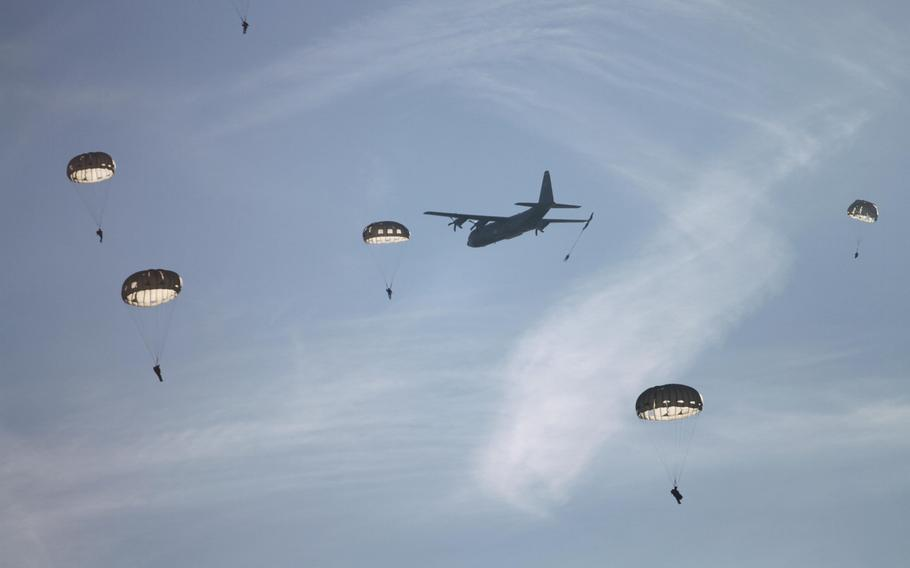 After taking off from Ramstein Air Base in a C-130, U.S. and European military personnel jump near the German town of Alzey Monday, Dec. 16, 2013, on the first day of International Jump Week.